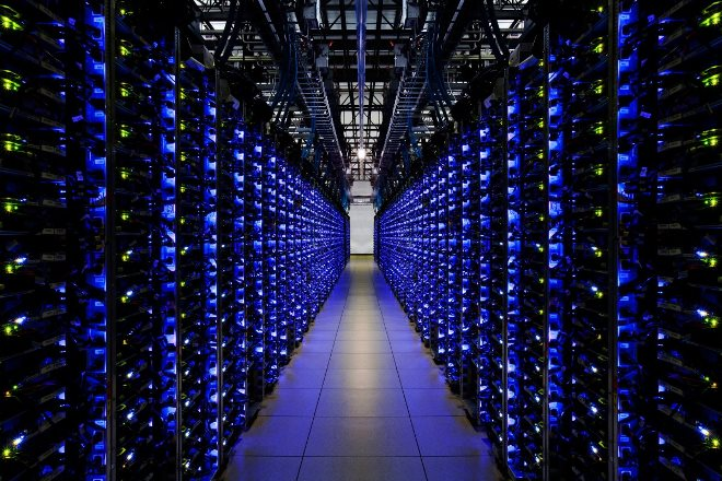 the-blue-leds-on-this-row-of-servers-let-employees-know-that-everything-is-running-smoothly-google-has-purchased-1000-megawatts-of-renewable-energy-to-power-these-dat